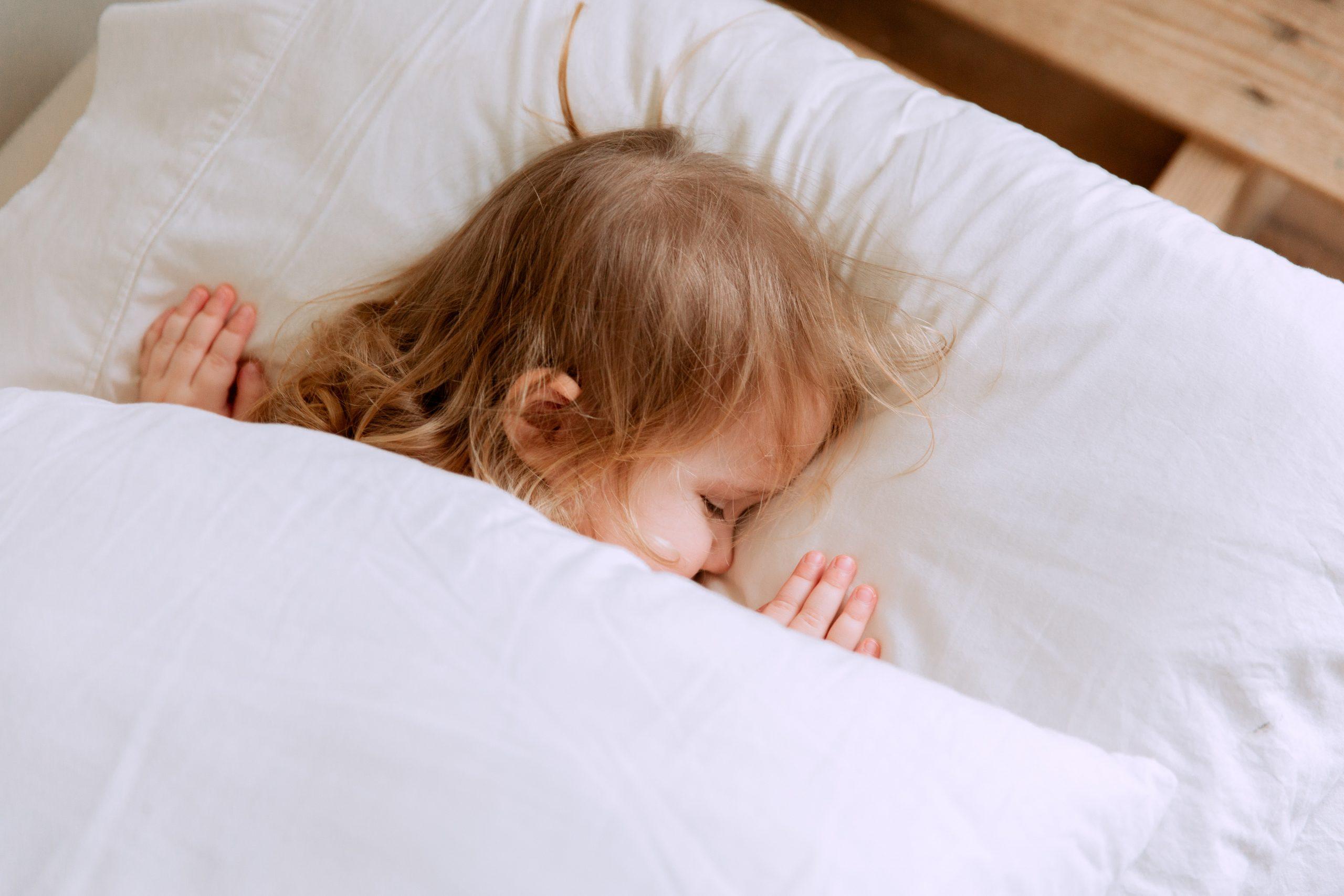 Sleeping toddler in bed